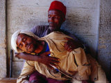 Man Holding Other Man Sick with Malaria, Ethiopia, Photographic Print
