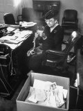F.D.R.'s Secretary of Labor Frances Perkins, Packing Up Souvenirs Including Twine and Box of Letters, Photographic Print