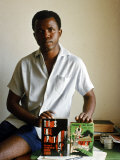 Nigerian Author Chinua Achebe Holding Two Editions of His Book Things Fall Apart, Photographic Print