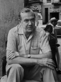 "Author Graham Greene Sitting on the Set of ""Our Man in Havana."", Photographic Print"
