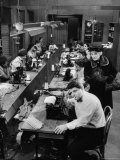 Playwright Paddy Chayefsky Sitting at Typewriter in Garment Factory With Workers on Sewing Machines, Photographic Print