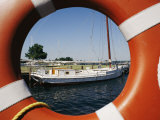 An Orange Life Preserver Frames a Sailboat at the Museum, Photographic Print