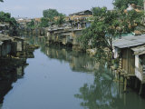 Ramshackle Houses Line a Canal in Jakarta, Indonesia, Photographic Print