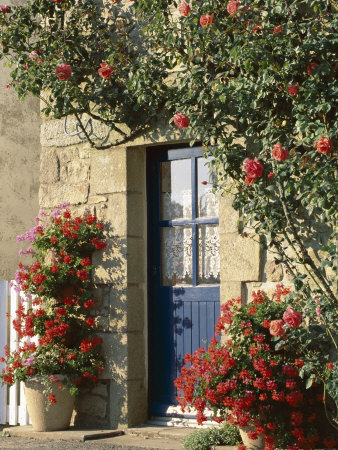 Exterior of a Blue Door Surrounded by Red Flowers, Roses and Geraniums, St. Cado, Brittany, France Photographic Print