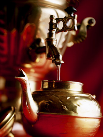 Water Running out of Samovar into a Pot Photographic Print