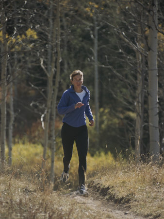 A Runner Takes an Autumn Jog Along Cache Creek Photographic Print
