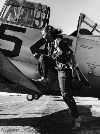 Female Pilot of the Us Women's Air Force Service Posed with Her Leg Up on the Wing of an Airplane Photographic Print