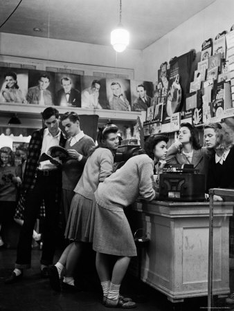 Teenagers Listening to 45 Rpm. Records as They Shop For the Latest Hits at a Record Store Photographic Print