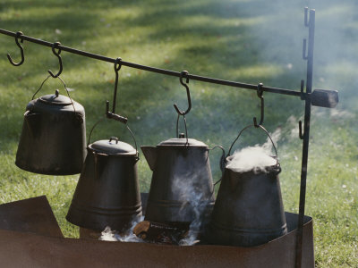Four Metal Coffee Pots Steaming over an Outdoor Grill Photographic Print