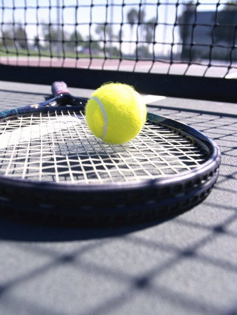Tennis Ball on a Tennis Racket Photographic Print