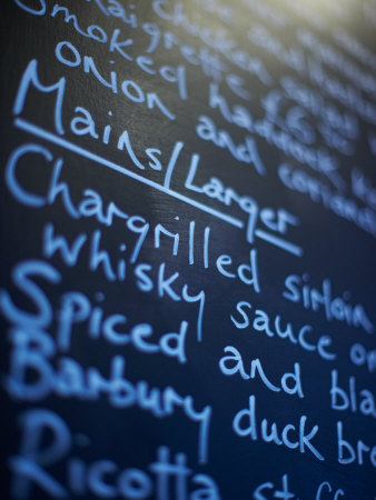 Close-Up of Restaurant Menu on Blackboard Photographic Print