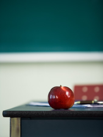 Bright Red Apple on Desk of Teacher in Classroom Photographic Print