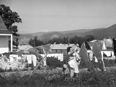 Housewife in Tygart Valley Removing Laundry from Clothesline, Her Young Daughter Stands Beside Her Photographic Print