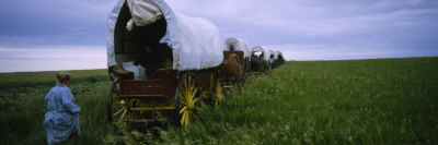Historical Reenactment of a Woman Running Behind a Covered Wagon, North Dakota, USA Photographic Print