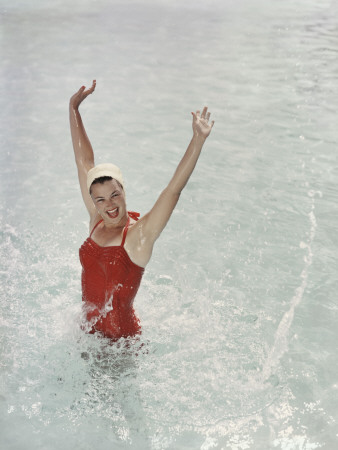 Happy Retro Girl Splashing Water with Arms Raised