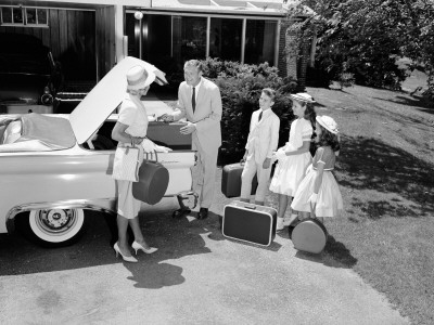 Family Packing Suitcases in Trunk of Car Parked on Driveway, Preparing For Vacation Photographic Print