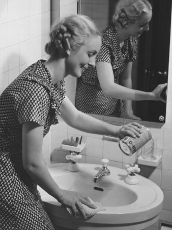 Young Woman Cleaning Bathroom Sink Photographic Print