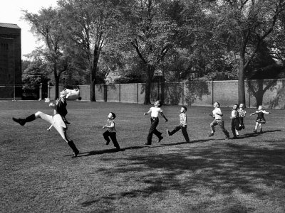 Uniformed Drum Major For University of Michigan Marching Band Practicing His High Kicking Prance Photographic Print by Alfred Eisenstaedt