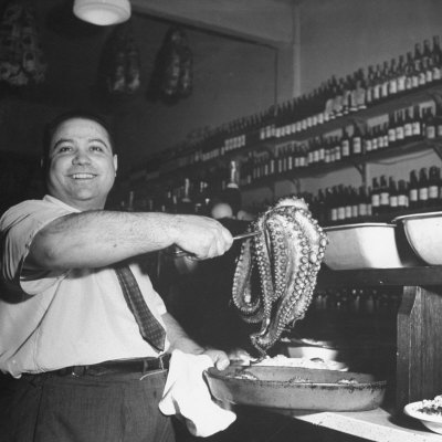 Cook in the Napoli Restaurant Holding up an Octopus, a Delicacy in Argentina Photographic Print by Thomas D. Mcavoy