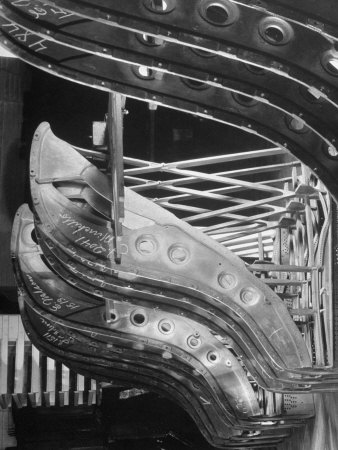 Harp-Shaped Steel String Frames in Racks Waiting to be Installed at the Steinway Piano Factory Photographic Print by Margaret Bourke-White