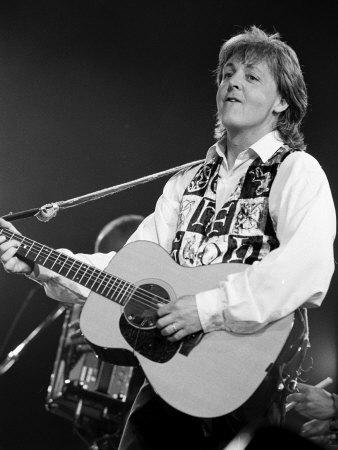 Paul McCartney Playing Guitar on Stage Metal Print