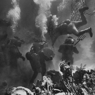 Propman Helping Seaweed Harvest During Underwater Filming of Disney's 20,000 Leagues Under the Sea Photographic Print by Peter Stackpole