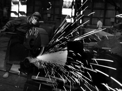 Japanese Worker Cutting Steel Pipe W. Huge Power Saw at Yawata Steel Mill Photographic Print by Margaret Bourke-White