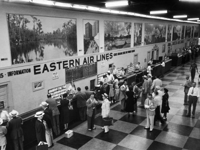 Eastern Airline Customers Checking in their Baggage at the Check-In Counter Photographic Print by Ralph Morse