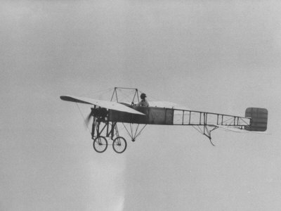 An Old Fashion Plane Flying at the Air Force's 50th Birthday Show Photographic Print