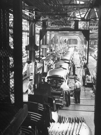 Employees Working on Cars as They Move Down Assembly Line Photographic Print by Ralph Morse