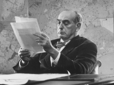 Robert Moses, Nyc Planner and Builder of Highways, Reading Document in His Office Photographic Print by Alfred Eisenstaedt