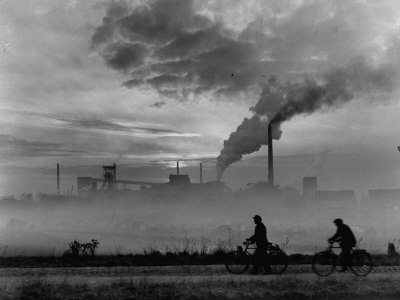 Steel Mill in Dusseldorf, German Steel Workers Bicycling Home from Work Photographic Print by Ralph Crane