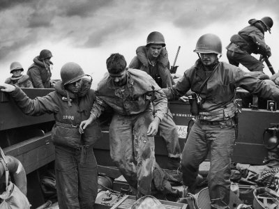 US Coast Guardsmen Assisting a Wounded Marine Returning from the Fight on Iwo Jima Photographic Print