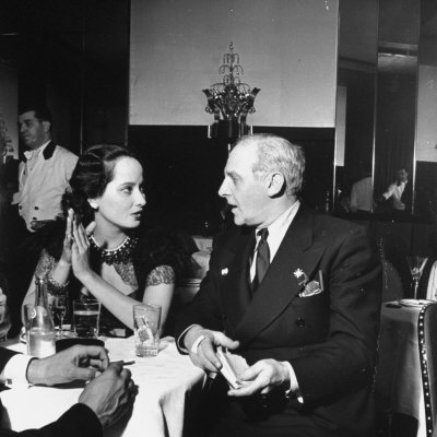 Merle Oberon and Walter Winchell Chatting at the Stork Club Photographic Print