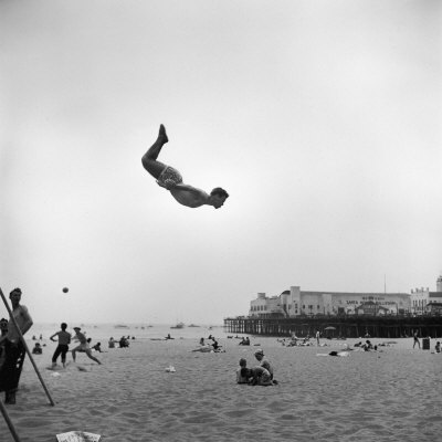 Man Flying Off a Trampoline at Santa Monica Beach Photographic Print by Loomis Dean