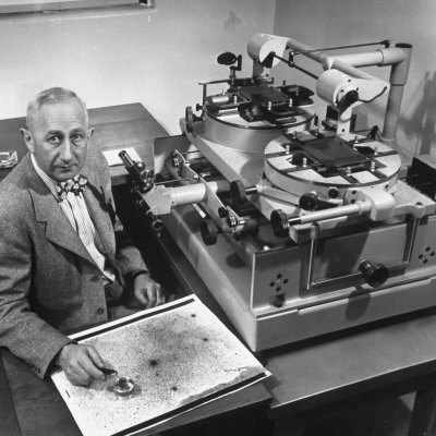 Astronomer Walter Baade Studying a Star Map Photographic Print by J. R. Eyerman