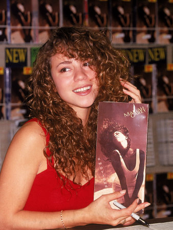 Singer Mariah Carey Signing Autographs During Personal Appearance Metal Print
