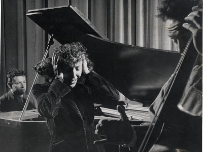 Singer Edith Piaf Holding Her Hands to Her Head While Performing with Pianist and Bass Player Premium Photographic Print by Gjon Mili