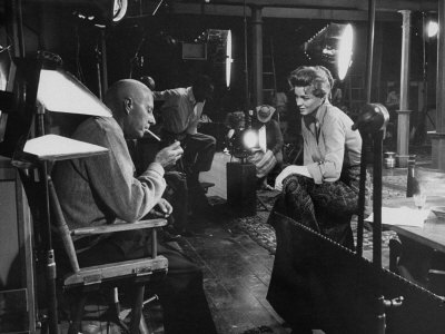 """Director Howard Hawks Conferring with Actress Angie Dickinson on Set for """"Rio Bravo"""" Metal Print by Allan Grant"""