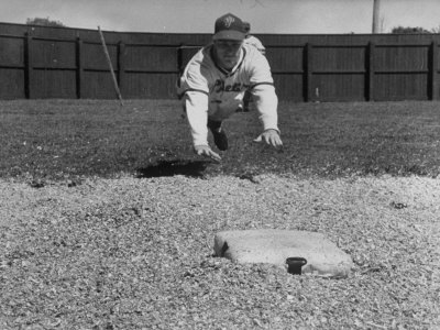 Baseball Player Richie Ashburn Making a Belly-Whopper Slide into Base During Practice Metal Print by Ralph Morse