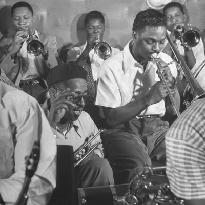 """Dizzy Gillespie, """"Bebop"""" King, with His Orchestra at a Jam Session Premium Photographic Print by Allan Grant"""
