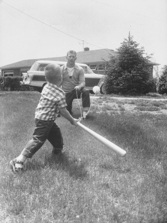 Mickey Mantle's Son Batting at Ball Pitched by Him Metal Print by Ralph Morse