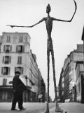 Skeletal Giacometti Sculpture on Parisian Street Photographie par Gordon Parks