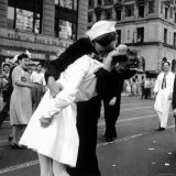 US Sailor Bending Young Nurse over His Arm to Give Her Passionate Kiss in Middle of Times Square Photographic Print by Victor Jorgensen