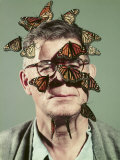 Butterfly Breeder Carl Anderson with Monarch Butterflies on His Face Premium Photographic Print by John Dominis