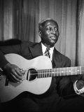 Singer Huddie Ledbetter known as Leadbelly Premium Photographic Print by Bernard Hoffman