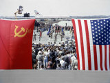 Soviet and American Flags Blowing over Welcoming Ceremonies for Soviet Premier Nikita Khrushchev Premium Photographic Print by Hank Walker