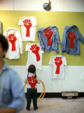 T Shirts Bearing a Red Fist Symnolizing Support of a Student Strike at Harvard University Premium Photographic Print by Leonard Mccombe