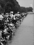 People at Civil Rights Rally Soaking their Feet in the Reflecting Pool at the Washington Monument Premium Photographic Print by John Dominis