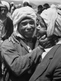 Algerian Refugees Greeting Each Other after Returning from Tunisia Premium Photographic Print by Hank Walker